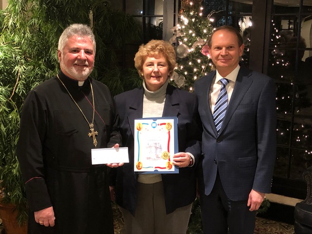 Fr. Pankiw receiving donation